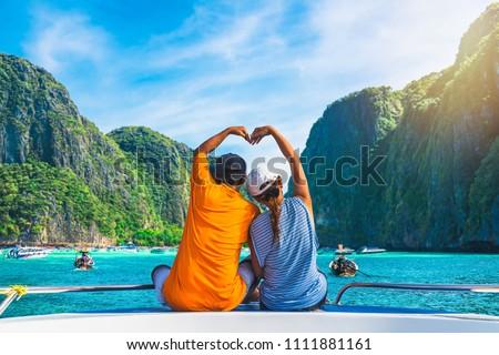 Happy couple traveler doing heart shape joy relaxing on boat Maya beach, Krabi Phuket, Travel adventure nature Thailand, Tourist beautiful destination place Asia, Summer holiday outdoor vacation trip Foto stock ©
