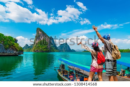 Happy couple traveler joy fun beautiful nature scenic landscape Phang-Nga bay, Adventure landmark travel Phuket Thailand, Tourist people on summer holiday vacation trip, Tourism destination place Asia