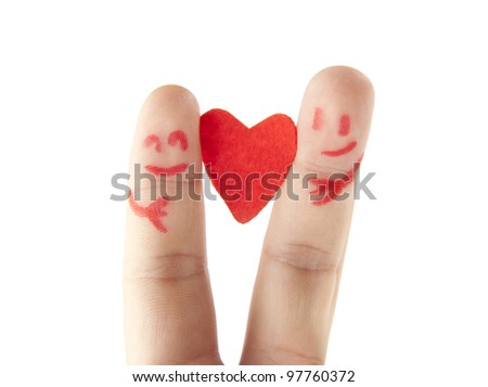 happy couple two fingers - the symbols of love couples - based on red heart - love the idea of ??inseparability of devotion - concept of two halves - the idea of ??a holiday of Valentine's Day