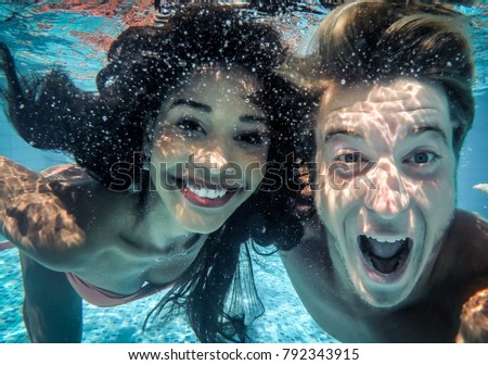 happy couple underwater #792343915