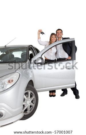 Happy couple with a car isolated over a white background
