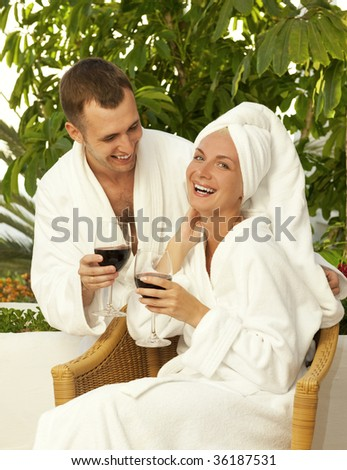 Happy couple with a glasses of wine outdoors