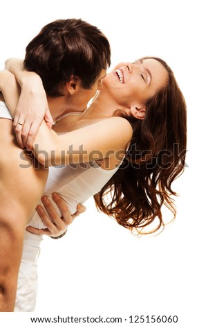 Happy couple with boyfriend hugging adult laughing woman