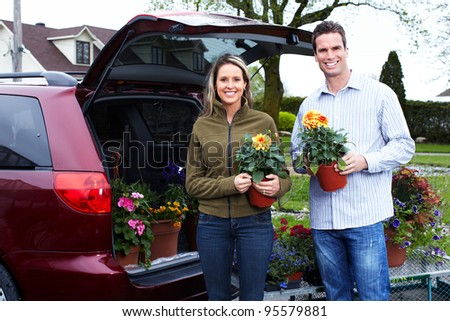 Happy couple with flowers. Gardening.