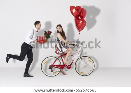 Shutterstock Happy couple with gift and heart shaped balloon