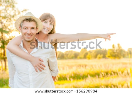 happy couple with outstretched arms showing finger