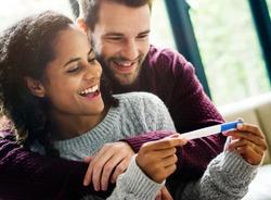 Happy couple with pregnancy news
