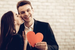 Happy Couple With Red Heart Origami. Valentine's Day. Love Each Other. Beautiful Holiday. Sweetheart's Celebration Concept. Young And Handsome. Feelings Showing. Cheerful Lovers. Romantic Kiss.