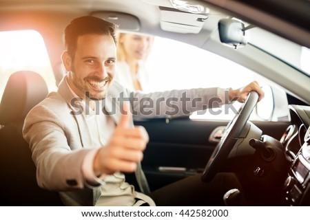 Happy customer just bought a car at car dealership #442582000