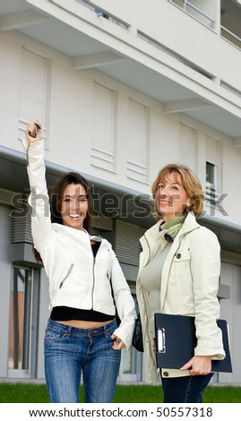 Happy customer woman rised hand with an apartment keys