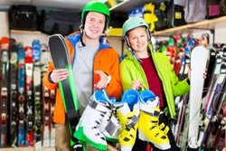 Happy customers are satisfied of their choice of ski and boots for skiing in sport shop