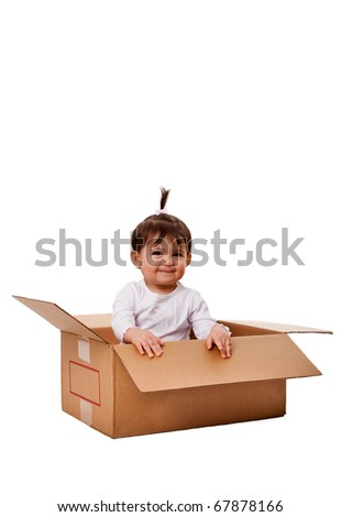 Happy cute baby girl in brown moving storage surprise box, isolated.