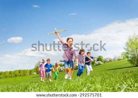 Shutterstock Happy cute boy with plane toy and chasing him kids