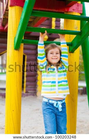 Happy cute child having fun at playground