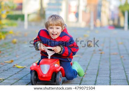 happy cute kid boy in colorful...