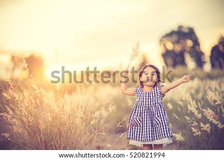 happy cute kid in a field...