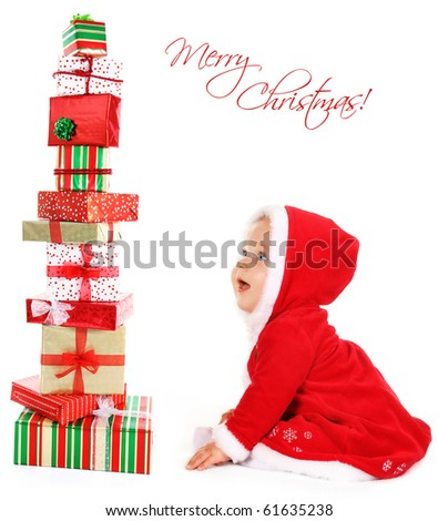 Happy, cute, smiling Christmas  baby sitting with gifts isolated on white.