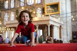 happy cute  Turkish boyboy in a mosque