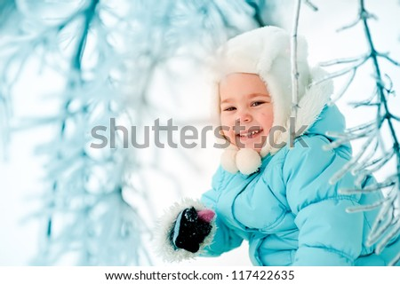 happy cute winter girl at snow trees background