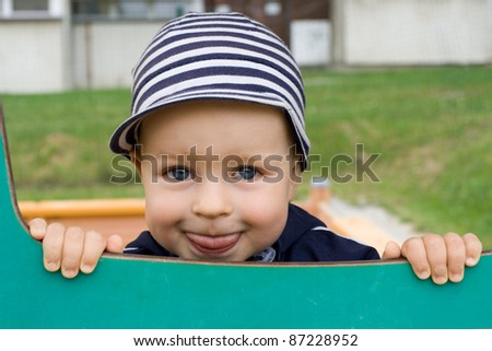 Happy cute young boy smiling on the playground