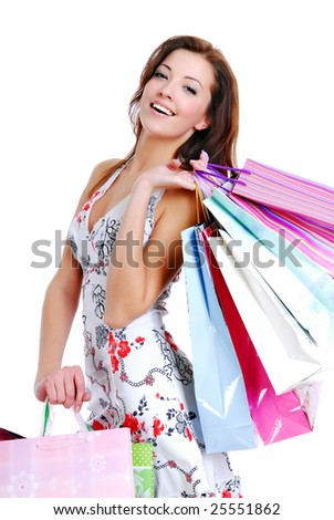 happy cute young woman shopping with color bags - isolated on white