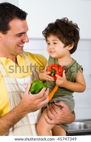 happy dad and son in kitchen