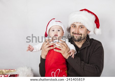 Happy dad with baby in festive clothes and Christmas interior,. Christmas, Holidays, New Year