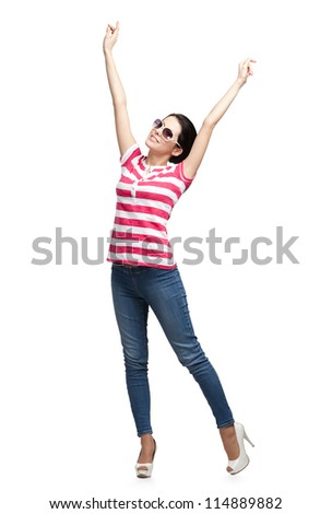 Happy dancing teenager with arms up, isolated. Fashion woman