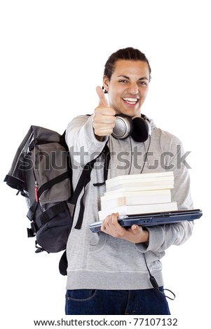Happy dark-skinned student with books holds thumb up.Isolated on white background.