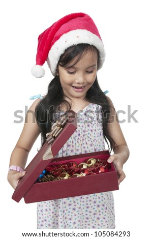 Happy daughter smiling when open christmas box