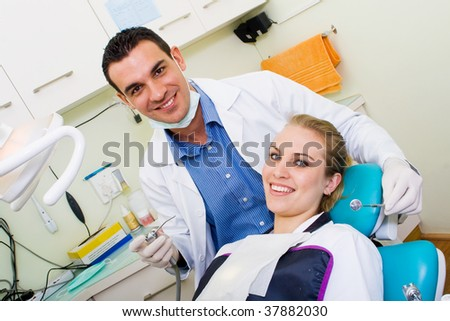happy dentist and patient in dentist's office