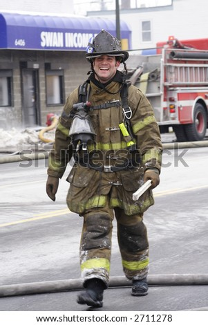Happy Detroit fireman walking down the street after putting out a fire