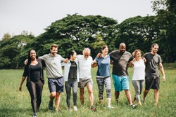 Happy diverse people enjoying together in the park
