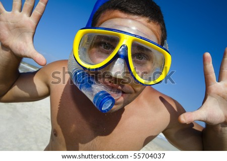 Happy diving man in a swimming mask and snorkel. Funny picture.