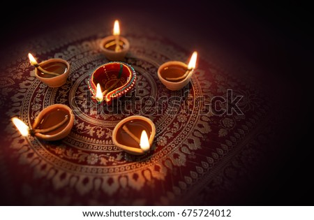 Happy Diwali - Diya lamps lit during diwali celebration #675724012