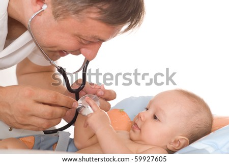 happy doctor examining newborn
