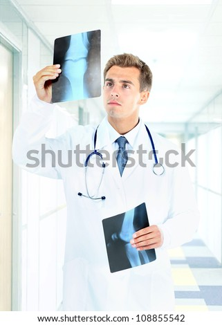 Happy doctor looking at x-ray