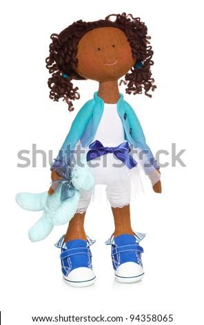 Happy doll on white background - stock photo
