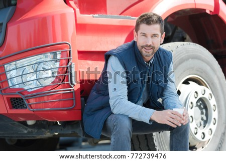 happy driver next to his lorry