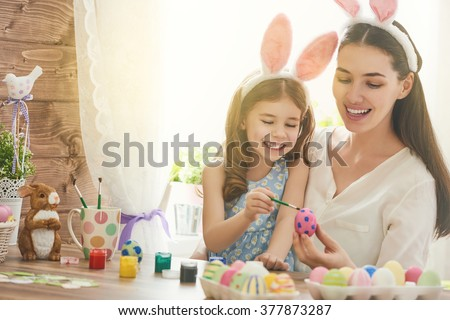 happy easter  a mother and her...