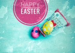 Happy easter card background idea, Colorful easter egg decorate with paper flower in shopping cart with space on blue texture background, vintage tone style