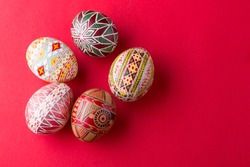happy easter card. beautiful Easter egg Pysanka handmade - ukrainian traditional on a red background