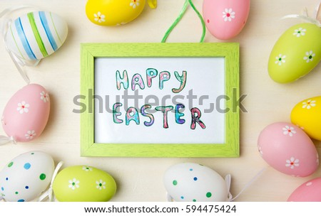 Happy Easter card in a wooden frame with colorful eggs
