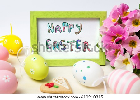 Happy Easter card in a wooden frame with colorful eggs #610910315