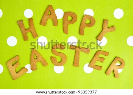 Happy Easter Card On green fabric. Words HAPPY EASTER on a tureen fabric background, festive card for Easter holiday.