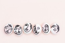 Happy Easter concept. Surreal faces on eggs on pink background. Art und Online style. Top view Flat lay Copy space.
