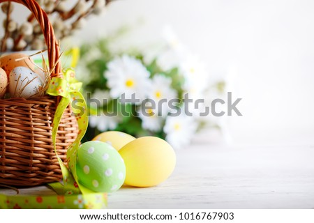 Happy Easter. Congratulatory easter background. Easter eggs and flowers. #1016767903