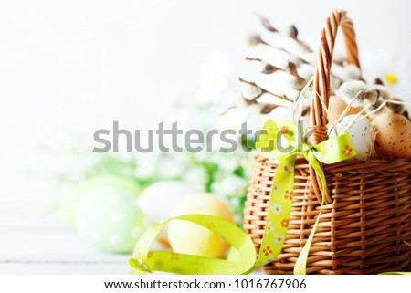 Happy Easter. Congratulatory easter background. Easter eggs and flowers. #1016767906