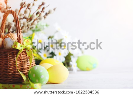 Happy Easter. Congratulatory easter background. Easter eggs and flowers. #1022384536