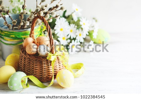 Happy Easter. Congratulatory easter background. Easter eggs and flowers. #1022384545